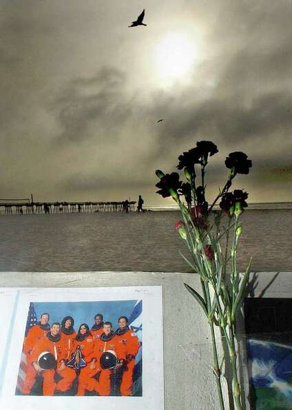 A makeshift memorial is placed near the Hermosa Beach Pier, in Hermosa, Calif., Saturday, Feb. 1, 20