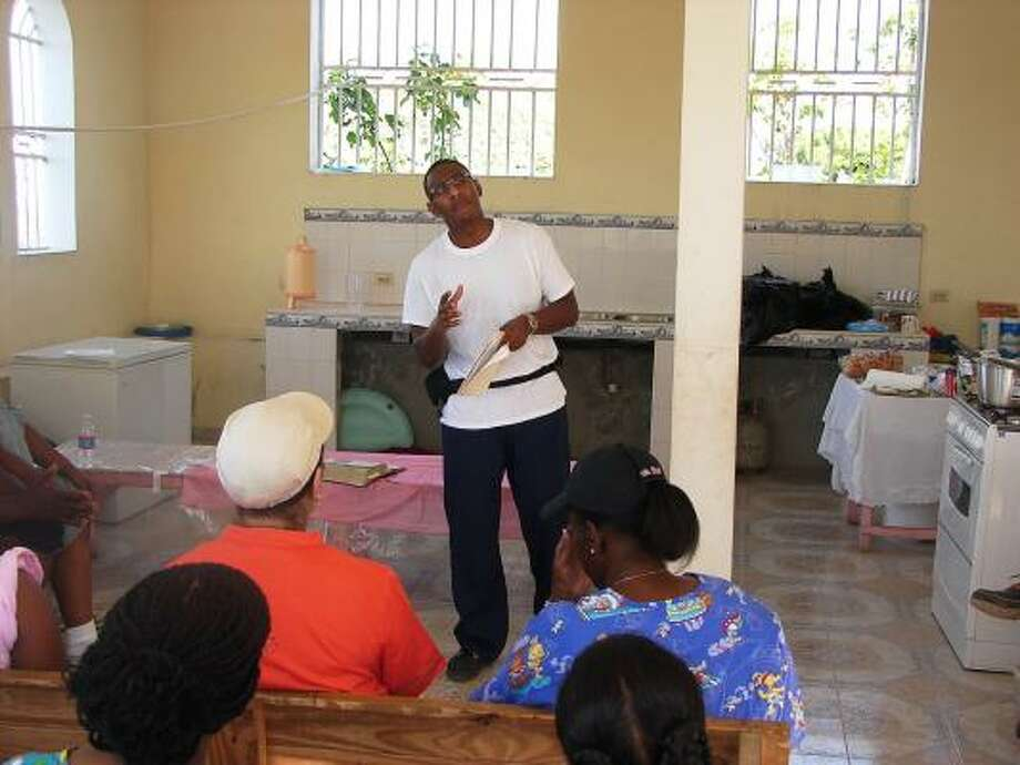The Rev. Trey Thomas of Houston's Lilly Grove Baptist Church speaks at its mission church in Cabaret, Haiti, during a recent trip to the earthquake-ravaged country. Photo: PHOTO COURTESY TREY THOMAS