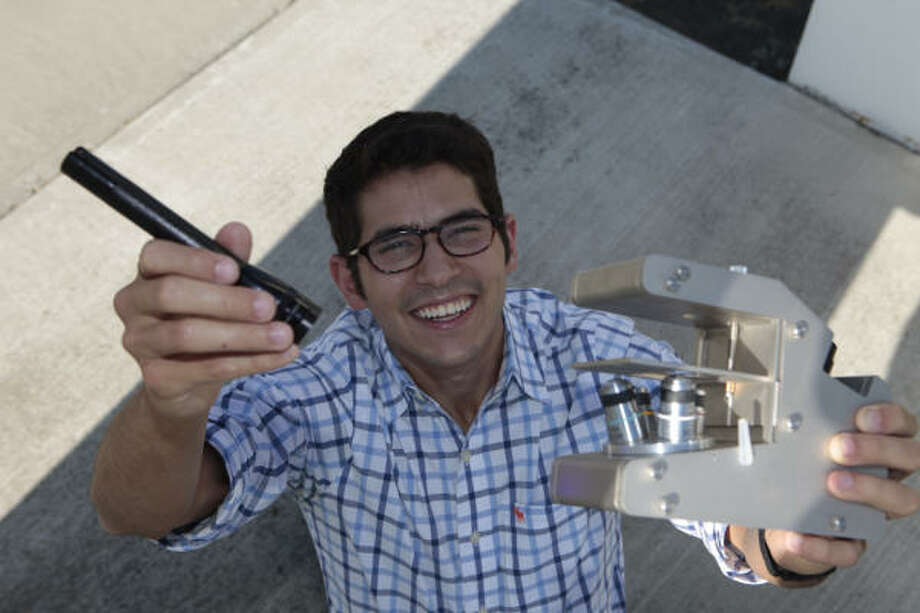 Andrew Miller's 2½-pound, battery-powered microscope performs as well as a $40,000 piece of hospital equipment, his professors at Rice University say.  But Miller's costs $220. Photo: Jenifer Sanchez, For The Chronicle