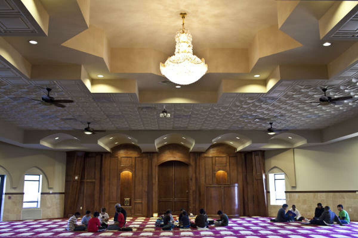 Children ages 7-16 study the Quran and Arabic at Sugar Land's Maryam Masjid, whose prayer area can accommodate 1,300 people.