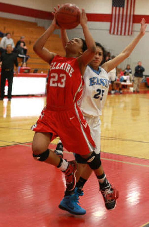 A.J. Alix, left, led Bellaire with 35 points, including 19 in the fourth quarter. Photo: Gary Fountain, For The Chronicle