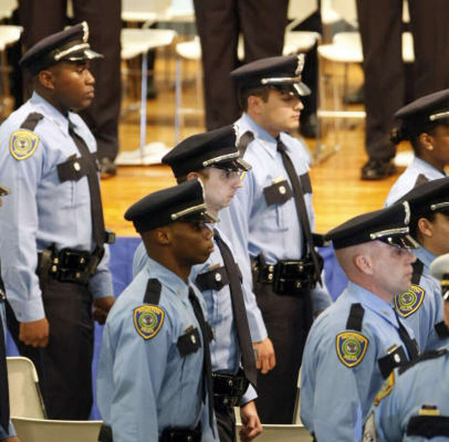 The newest members of Houston's thin blue line are presented during graduation ceremonies last year for the Houston Police Academy's Cadet Class 202. Photo: Nick De La Torre, Chronicle