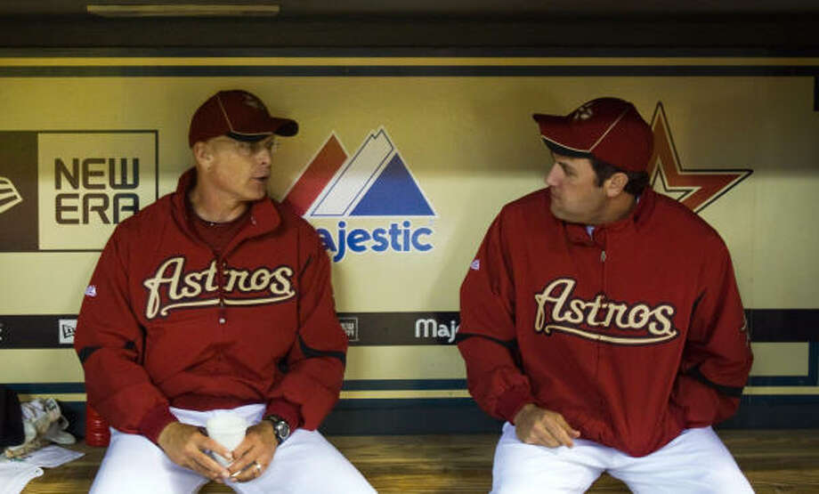 Astros manager Brad Mills, left, didn't put a target date on Lance Berkman's return. Photo: Smiley N. Pool, Chronicle