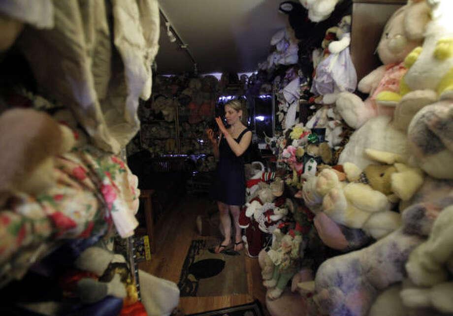 Erin Seeherman, of Philadelphia, takes pictures of stuffed bunnies while visiting the Bunny Museum in Pasadena, Calif. Below is the popular Elvis Parsley pitcher. Photo: Jae C. Hong, Associated Press