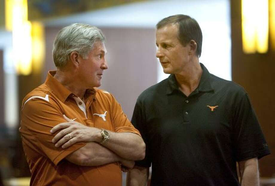 Texas' Mack Brown, left, and Rick Barnes are set to remain in the Big 12 coaches fraternity for the long haul. Photo: Laura Skelding, AP