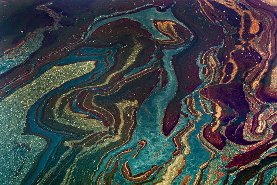 Oil from BP's Macondo well creates an eerie tapestry in the Gulf of Mexico near Orange Beach, Ala. Environmentalists said the federal judge who rejected the ban on deep-water drilling was overlooking the risk of another such spill. Photo: Kari Goodnough, Bloomberg