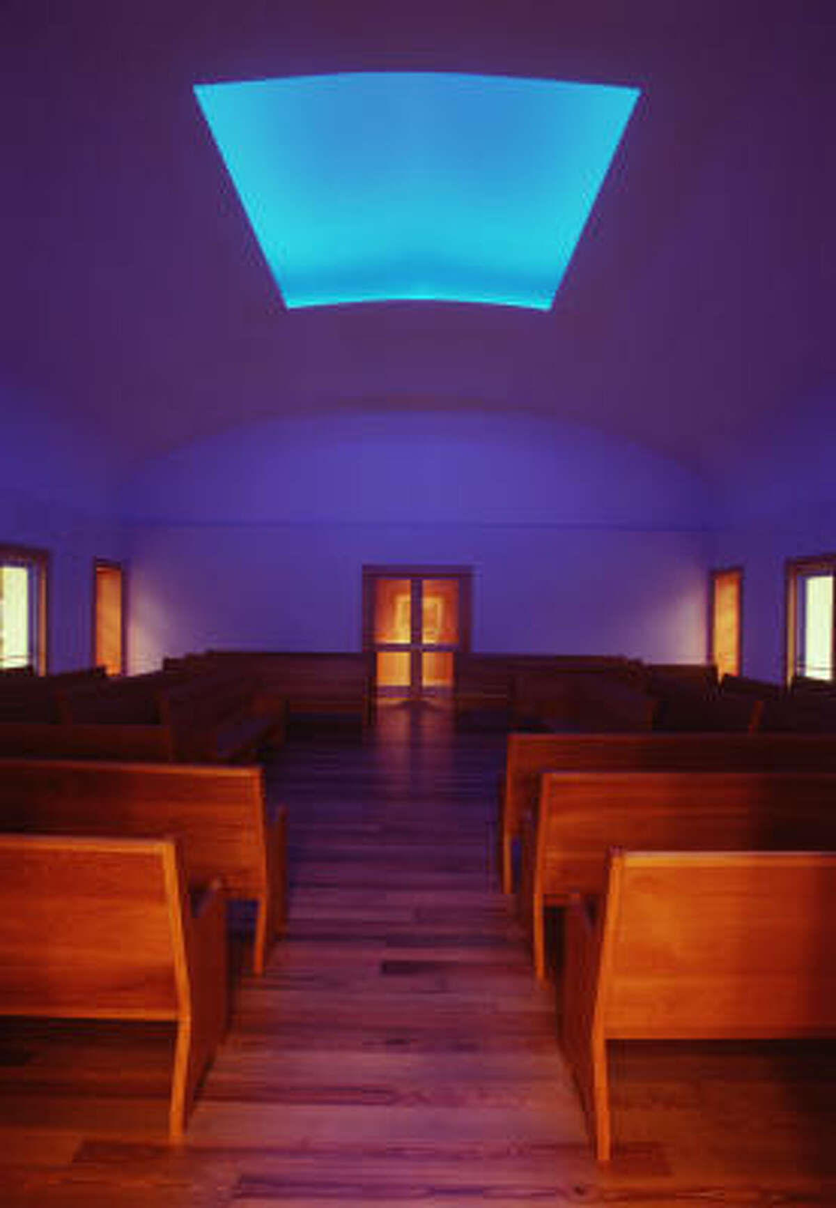 Photos of artist James Turrell's Skyspace from before the roof repairs show the diffferent qualities of light the work lets into the Live Oak Friends Meeting House.