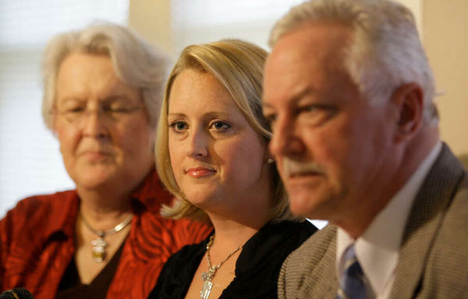 "Nikki Araguz, center, joined her lawyers Monday at a news conference at which she said there was ""no question my husband knew exactly what was going on."" Photo: Melissa Phillip, Chronicle"