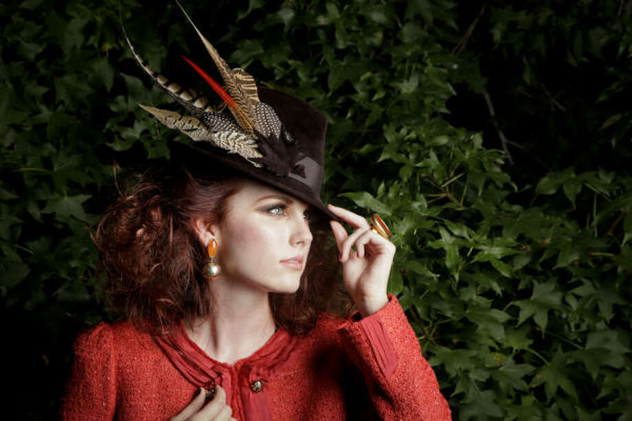 PUT A FEATHER IN YOUR CAP: McGinn jacket, $295, Nordstrom. Philip Treacy feathered hat, $850, Neiman Marcus. Earrings, $525, and ring, $675, Joseph. Photo: MICHAEL PAULSEN, CHRONICLE