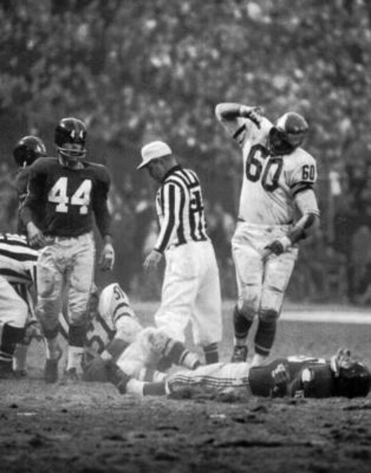 Philadelphia Eagles linebacker Chuck Bednarik (60) stood over an unconscious Frank Gifford after he leveled the New York Giants halfback on Nov. 20, 1960, at New York's Yankee Stadium. The impact of the hit sent Gifford to the hospital with a concussion. Fifty years later, NFL commissioner Roger Goodell has promised the stiffest penalties in league history for vicious hits. Photo: John G. Zimmerman, Associated Press