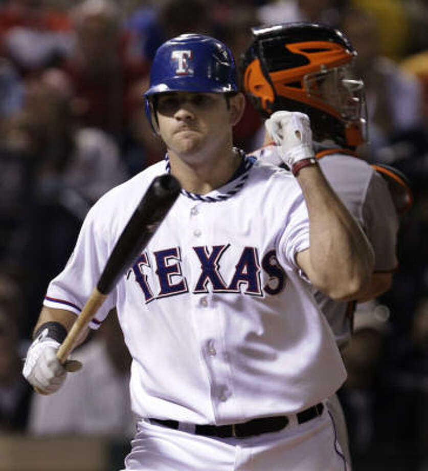 The Rangers' Mitch Moreland is upset at becoming the 10th and final strikeout victim during Tim Lincecum's eight-inning stint. Photo: David J. Phillip, AP