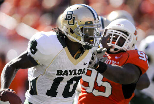 Quarterback Robert Griffin III and Baylor failed in the quest for first place in the Big 12 South. Photo: Brody Schmidt, AP