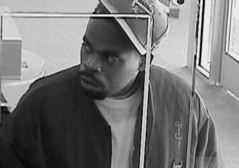 The FBI says this man tried to rob a Bank of America branch in western Harris County on Monday, but fled before getting any cash. Photo: Surveillance Photo