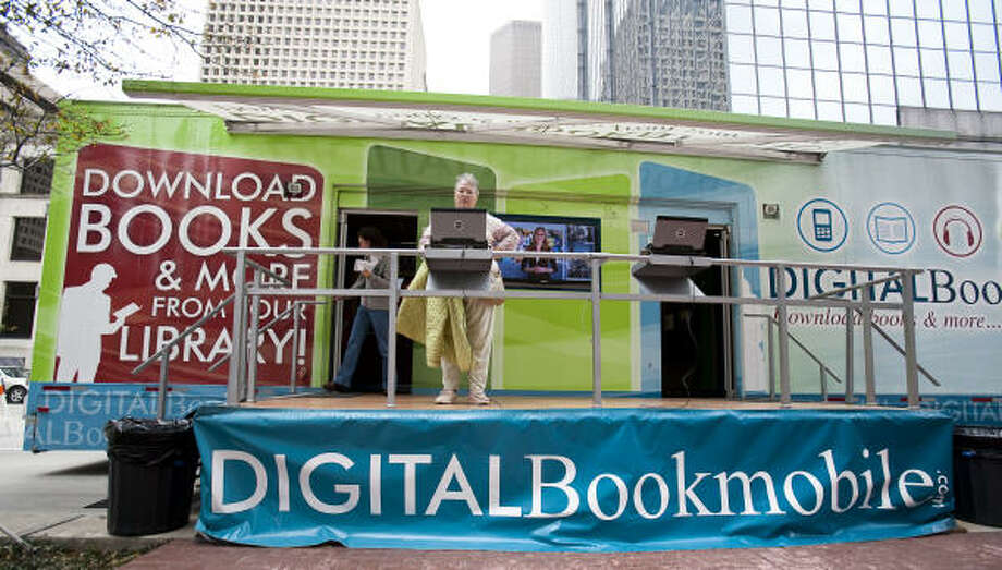 The Digital Bookmobile made a stop at the Houston Central Library last week as part of its national tour promoting free temporary downloads of digital books. Photo: Nathan Lindstrom