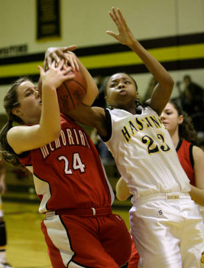 Memorial's Kelly Wilson, left, and Hastings' Darrian Page battle for a rebound. Photo: Melissa Phillip, Chronicle
