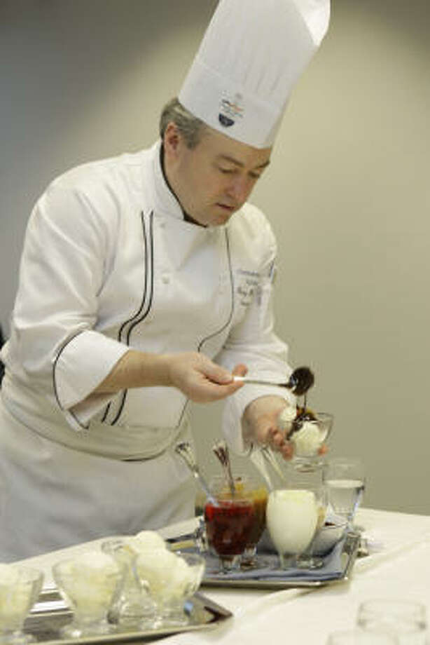 Gerry McLoughlin, Continental's Manager and Executive Chef of Food and Beverage Development, puts the finishing touches on an ice cream sundae, a popular BusinessFirst treat. Photo: Melissa Phillip :, Chronicle
