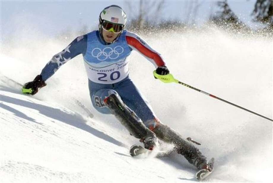 Bode Miller won his first gold medal in the super combined on Sunday. Photo: Gero Breloer, AP