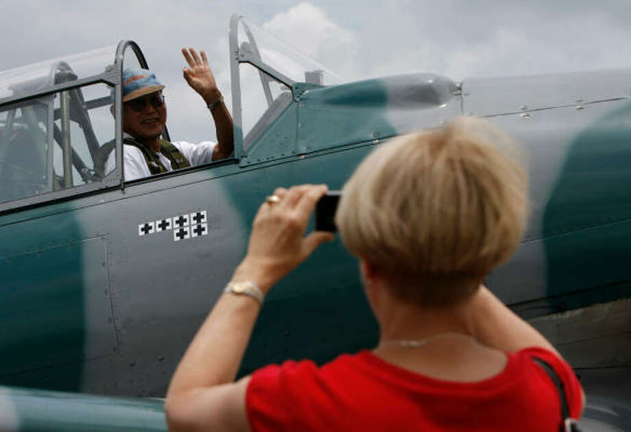 George Hirasaki, a professor at Rice University, got his ride in a T-6 Texan trainer as a Christmas gift from his wife, Darlene. Photo: Julio Cortez, Chronicle