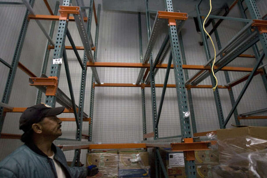 Greg Guerrero usually has to handle pallets stacked far above his head at the Montgomery County Food Bank. The nonprofit's 3,782-square-foot warehouse is running very short, however, and is appealing for help from local organizations. Photo: Johnny Hanson, Houston Chronicle