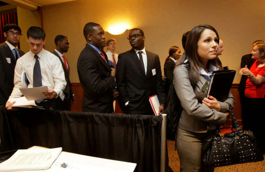 Elizabeth Osorio, a senior at the University of Houston majoring in accounting, waits to talk with representatives from Houston-based Noble Energy during a career fair this week. Photo: Melissa Phillip:, Chronicle
