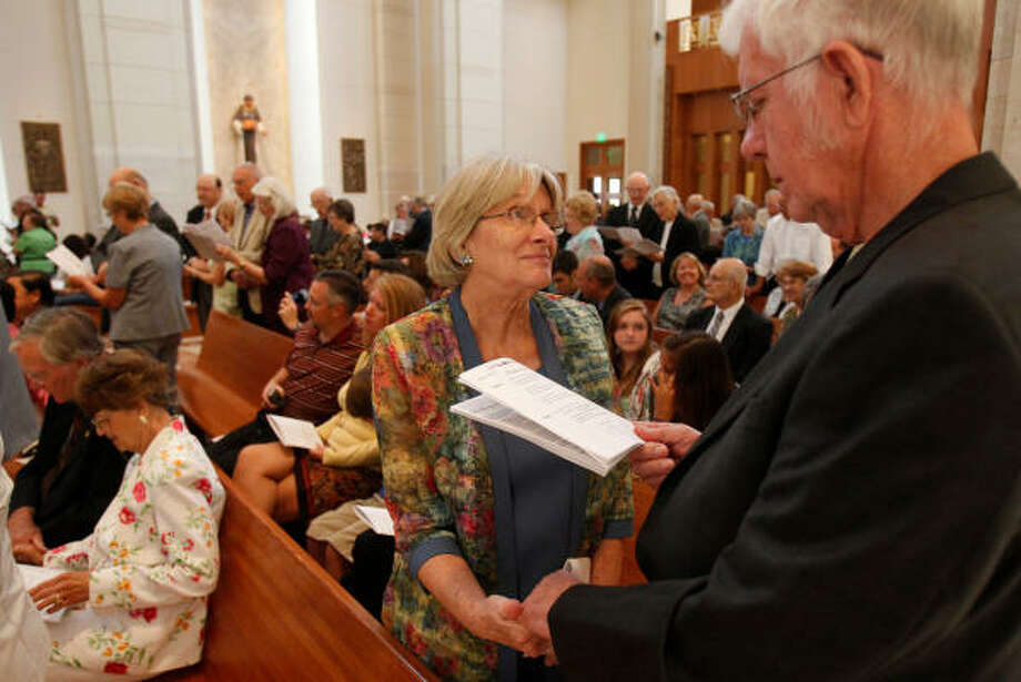 Vivian and George Hill, of Humble, renew their marriage vows during a special Mass Sunday. Photo: Melissa Phillip, Chronicle