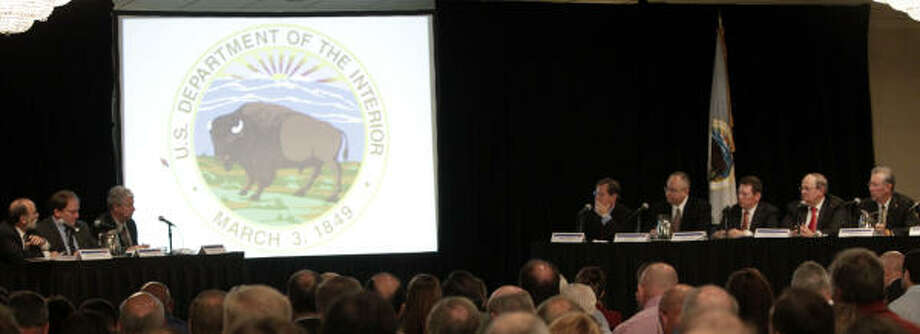 Bureau of Ocean Energy Management, Regulation and Enforcement Director Michael Bromwich, far left, as well as Troy Trosclair and William Hauser, ask questions of a panel, right, on Tuesday during a forum on offshore drilling. A task force presented preliminary findings on lessons learned from the Deepwater Horizon spill. Photo: Karen Warren :, Chronicle