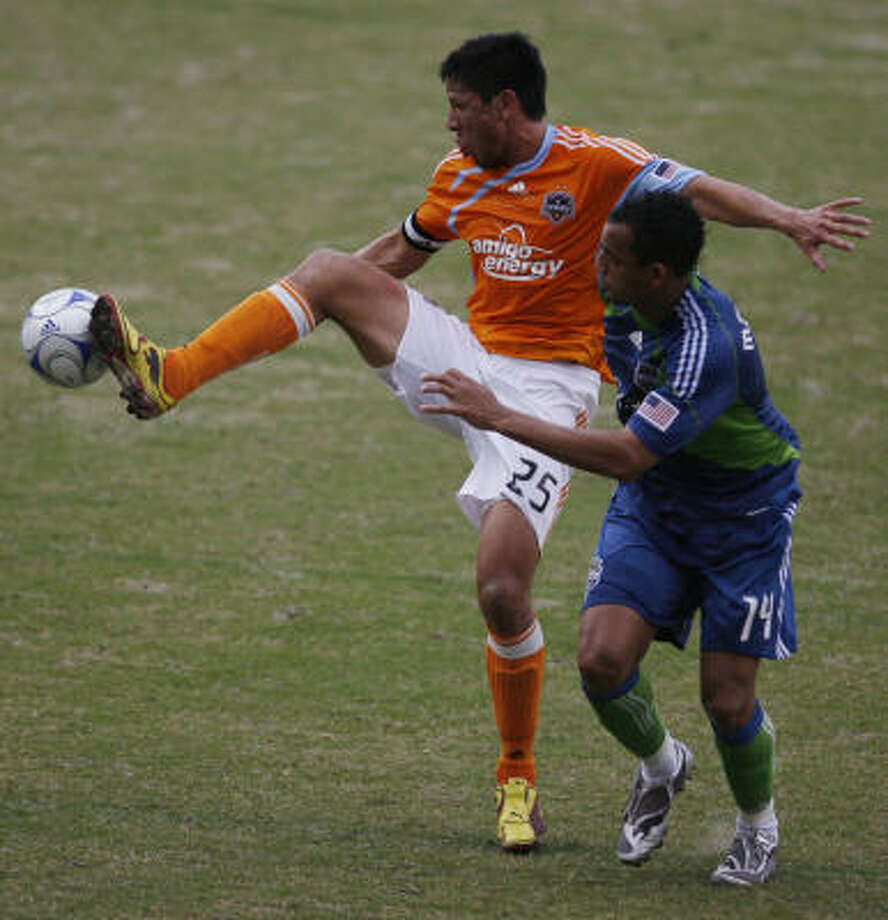Dynamo forward Brian Ching, left, was one of two commissioner's picks for the MLS All-Star Game. Photo: Julio Cortez, Houston Chronicle