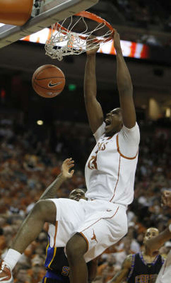 Texas forward Tristan Thompson throws down two of his 22 points in the victory Friday afternoon. Photo: Erich Schlegel, AP