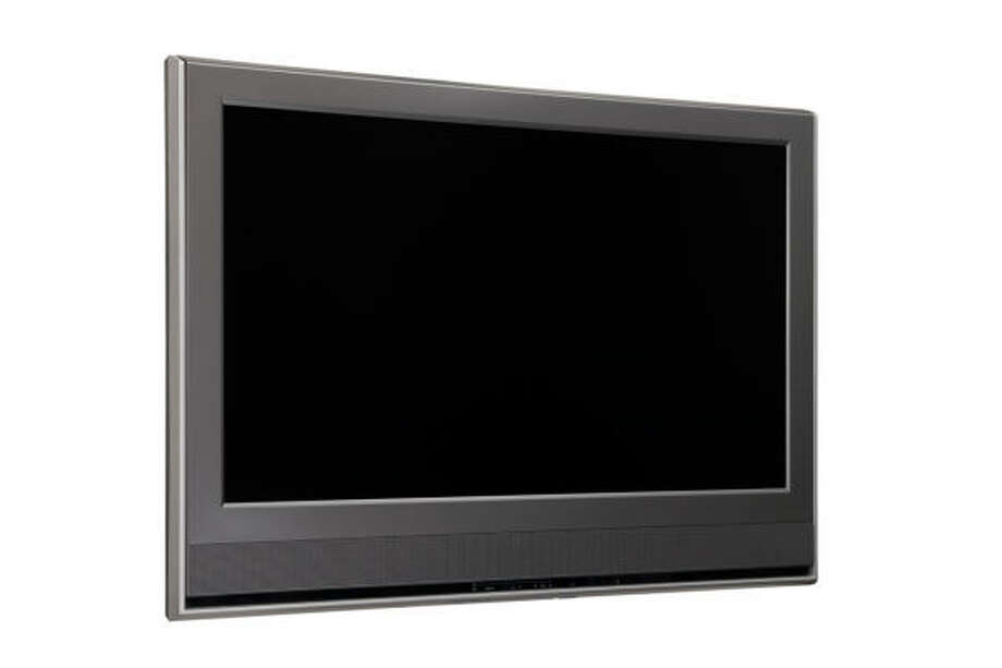 According to the Consumer Electronics Association, even as television set revenue is expected to drop in 2010, more consumers are making the transition to HD flat-panel sets. Photo: FOTOLIA