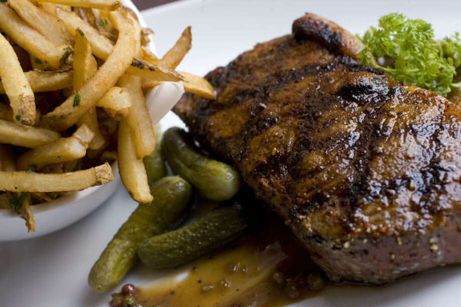The pepper strip steak has a forceful beef flavor that worked with its resilient texture, and the slim-cut fries make the perfect side. Photo: Billy Smith II :, Chronicle