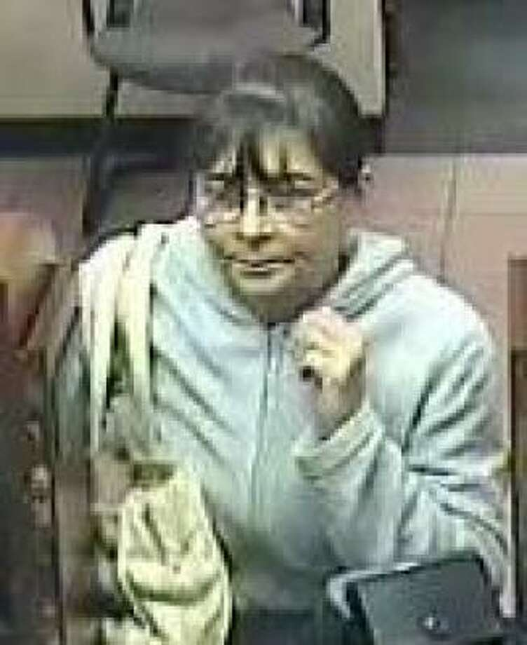 The woman in this image, taken from surveillance video, is wanted in the robbery today of a Wells Fargo bank branch. Photo: FBI