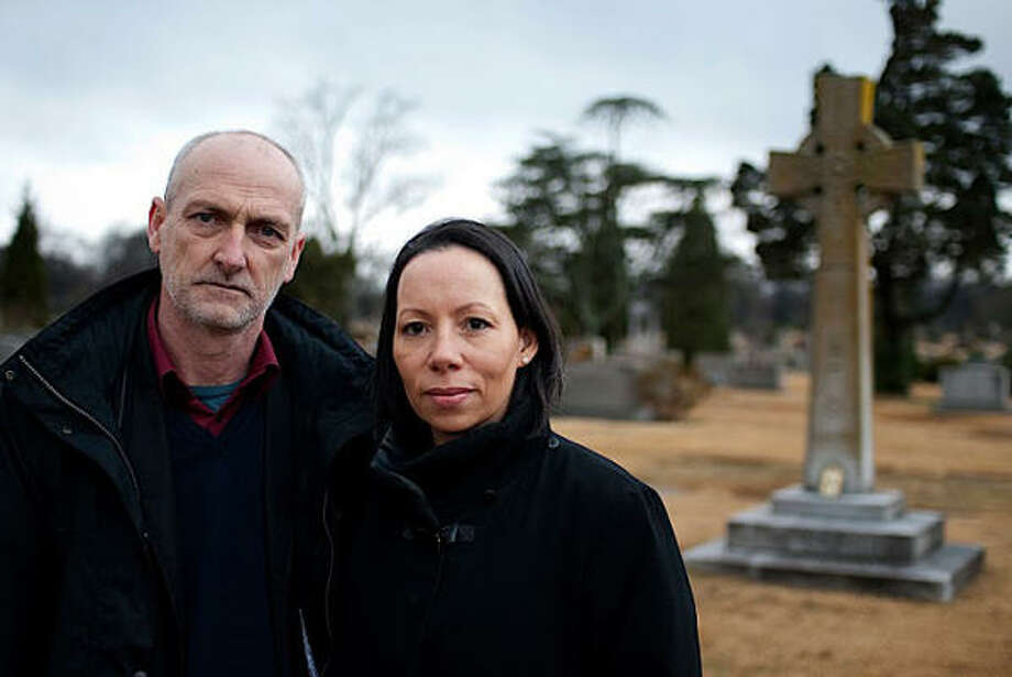 Sharon Davies, author of Rising Road, and Irish filmmaker Pat Shine visit the grave of the Rev. James Coyle in Birmingham, Ala. Both Davies and Shine, Coyle's grandnephew, have dug deeper into Coyle's 1921 murder at the hands of the Ku Klux Klan. Photo: THE BIRMINGHAM NEWS | RNS