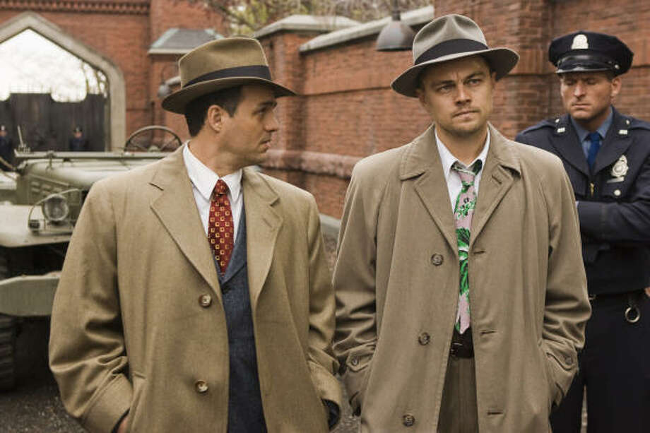 Chuck Aule (Mark Ruffalo, left) and Teddy Daniels (Leonardo DiCaprio) are two detectives sent from the mainland to investigate a mysterious disappearance from an island prison for the criminally insane in the thriller Shutter Island. Photo: Andrew Cooper, Paramount Pictures
