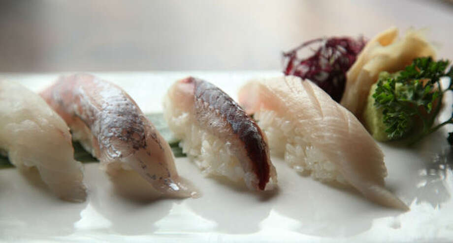 Sushi Raku flies in fish from Tokyo's famous Tsukiji fish market twice a week. Typically, two pieces of nigiri cost $7-$10. Photo: Mayra Beltran :, Chronicle
