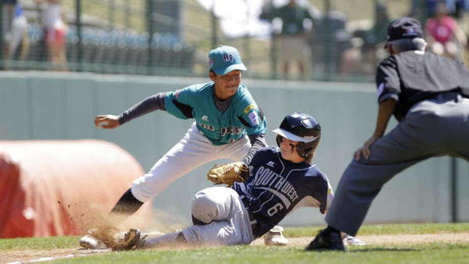 Pearland's Chris Leger slides into third as Taiwan's Shao-Fei Huang tries to apply the tag. Photo: Karen Warren, Chronicle