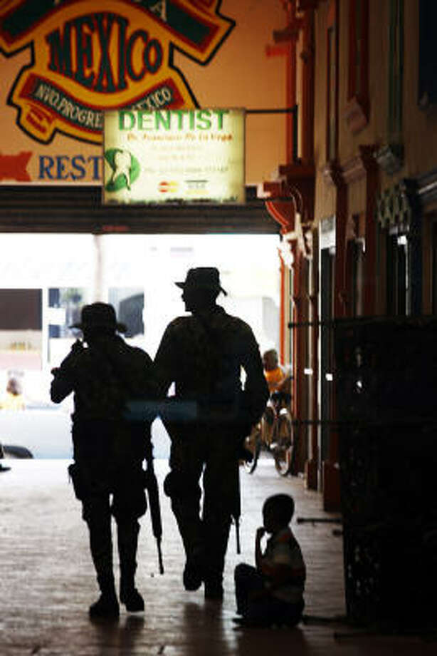 Mexican marines patrol in Nuevo Progreso, Mexico, across the Rio Grande from Weslaco. It's a popular destination for U.S. citizens seeking medicine and health care. Photo: Jerry Lara, San Antonio Express-News