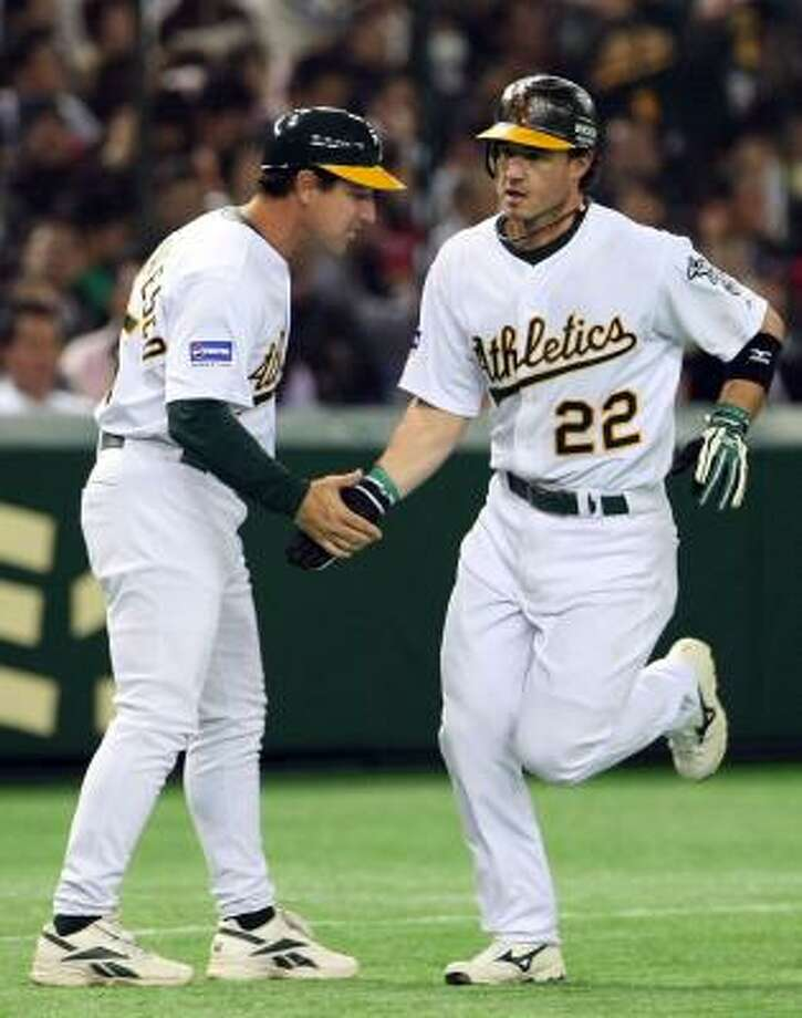 Tony DeFrancesco, left, served as third base coach for the A's in 2008. Photo: Koichi Kamoshida, Getty Images
