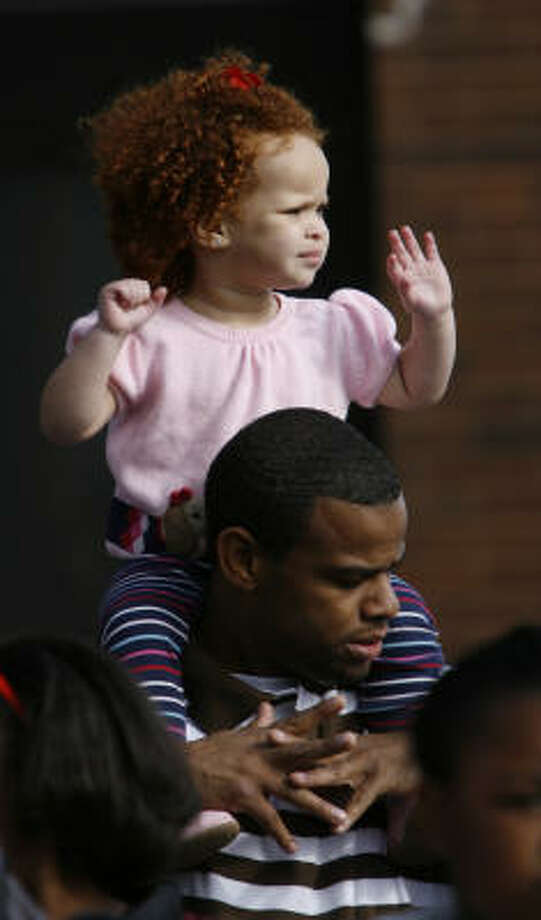 Richard Shandy holds Layla Shandy, 2, on his shoulders during the Black Heritage Society's MLK Day parade Monday in downtown Houston. Photo: Karen Warren, Chronicle