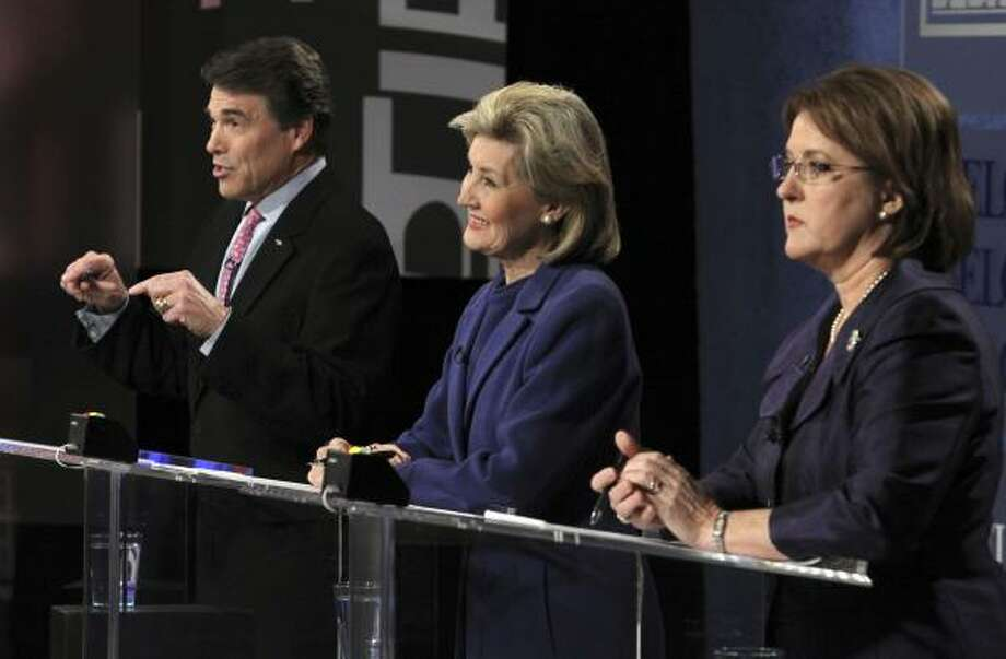 Gov. Rick Perry, U.S. Sen. Kay Bailey Hutchison, center, and Debra Medina face tough questions at a debate televised from Dallas on Friday. Photo: Louis DeLuca, Associated Press