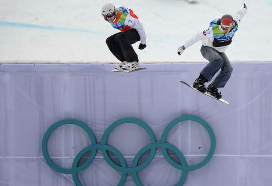 Seth Wescott of the U.S., right, races Mike Robertson of Canada toward the finish. Photo: Mark J. Terrill, AP
