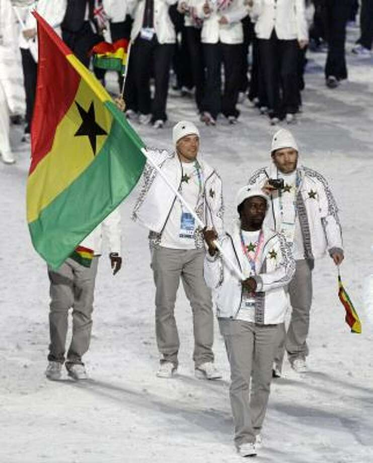 Kwame Nkrumah-Acheampong, Ghana's first Winter Olympian, carries his country's flag in the Opening Ceremony. Photo: Amy Sancetta, AP