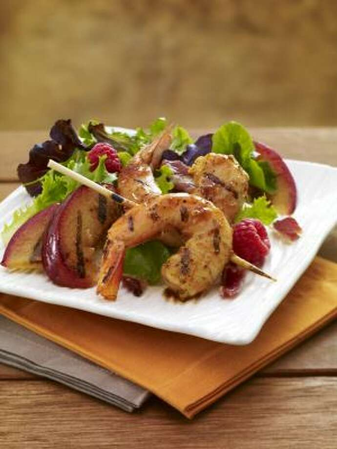 Applewood grilled shrimp and plum salad with cinnamon honey dressing is a great outdoor-barbecue dish. Photo: McCORMICK