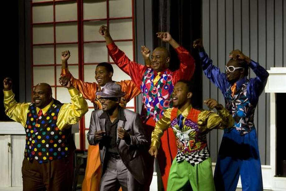 In Ensemble Theatre's production of Five Guys Named Moe, Nomax (T.C. Carson), foreground center, receives a makeover and relationship advice from Eat Moe (Anthony Boggess-Glover), from left, No Moe (Chioke Coreathers), Big Moe (Carlton Leake), Little Moe (Donald Collier) and Four-Eyed Moe (Tommie Harper III). Photo: Johnny Hanson :, Chronicle