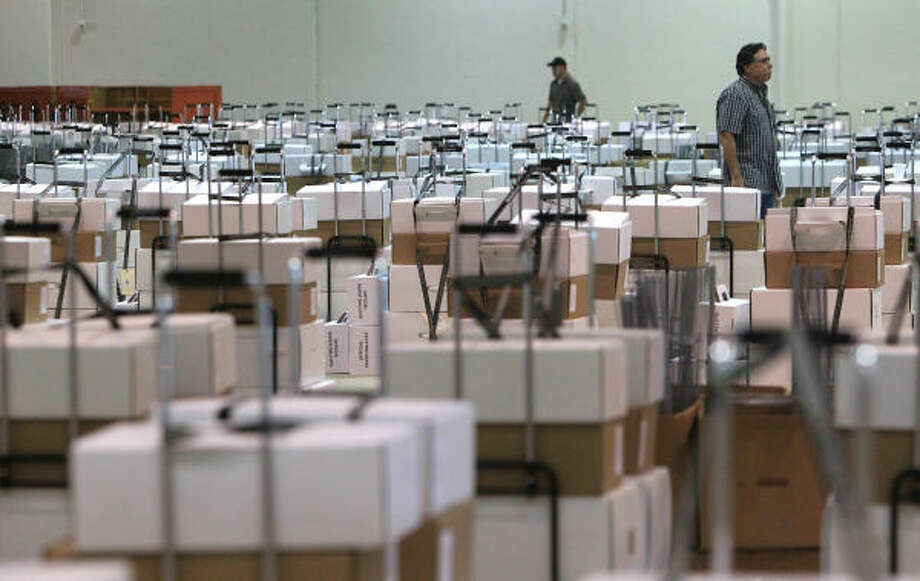 Reliant Arena is stuffed Sunday with Election Day materials ready to be distributed to Harris County's hundreds of precincts before voters go to the polls on Tuesday. Photo: Mayra Beltran, Chronicle