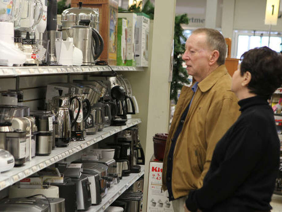 Gary Levy and his wife, Jan Levy, look over kitchen appliances on Thursday at Bering's Westheimer location. Sales of small kitchen appliances have increased by 4 to 5 percent the last two years, electronics consultant Steve Deason says. Photo: James Nielsen:, Chronicle