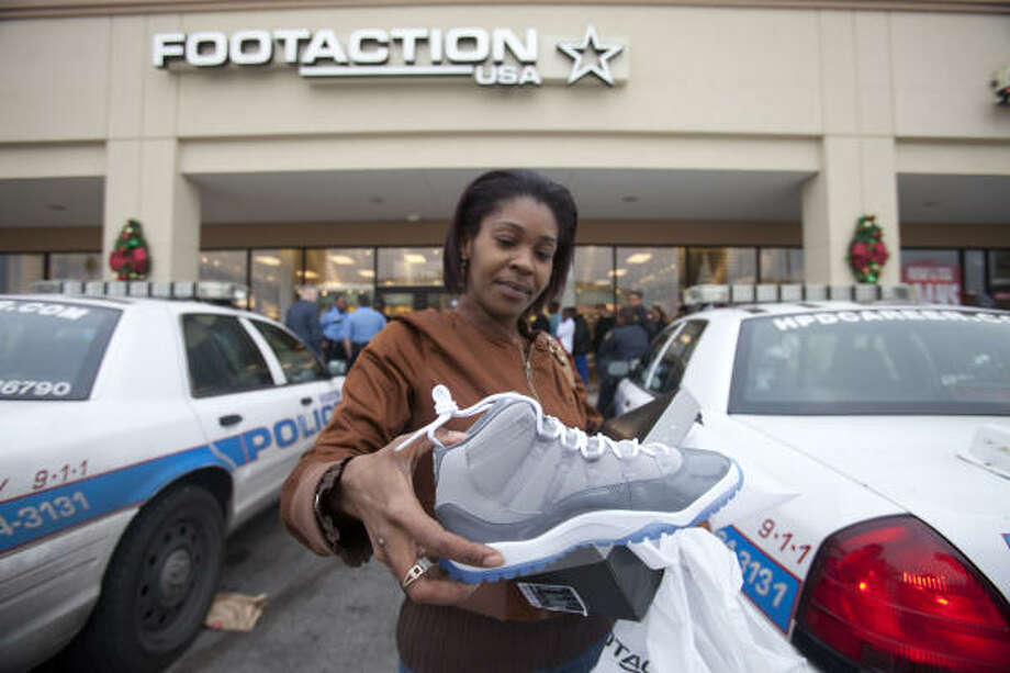 TaToyia Sophus gets her hands on Air Jordan shoes at Northline Mall, where police were called after a disturbance. Photo: Eric Kayne