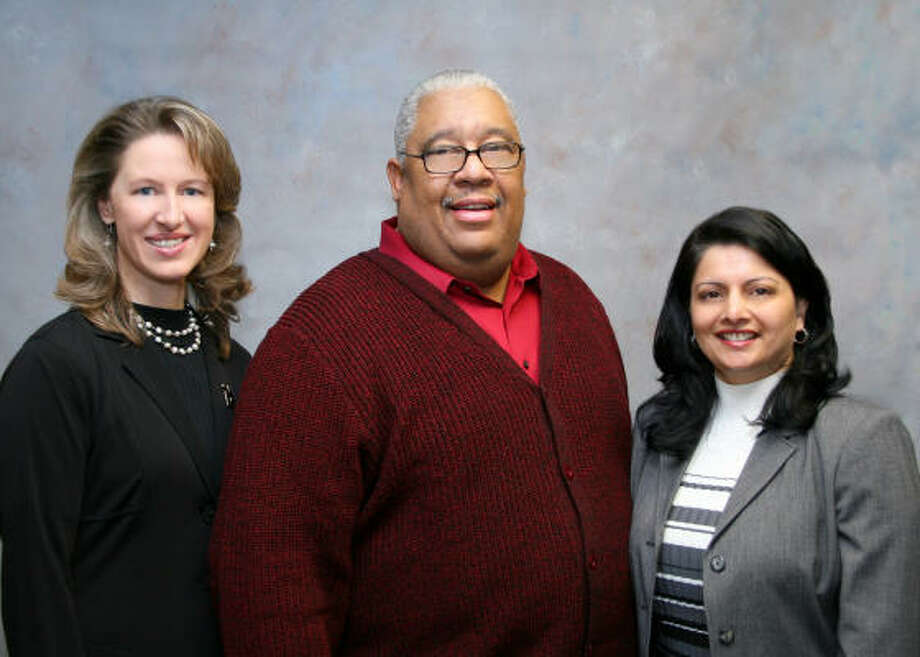 READY TO SERVE: Houston Community College Board of Trustees recently elected some its own to top positions. Sandie Meyers, left, is the board's new secretary William P. Williams, is the new board chairman and Neeta Sane, is the new vice chairman.