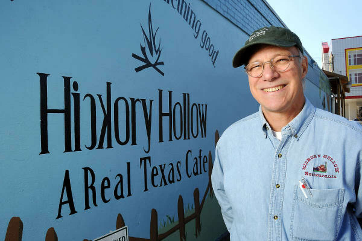 Hickory Hollow owner Tony Riedel stands in front of his Heights location.