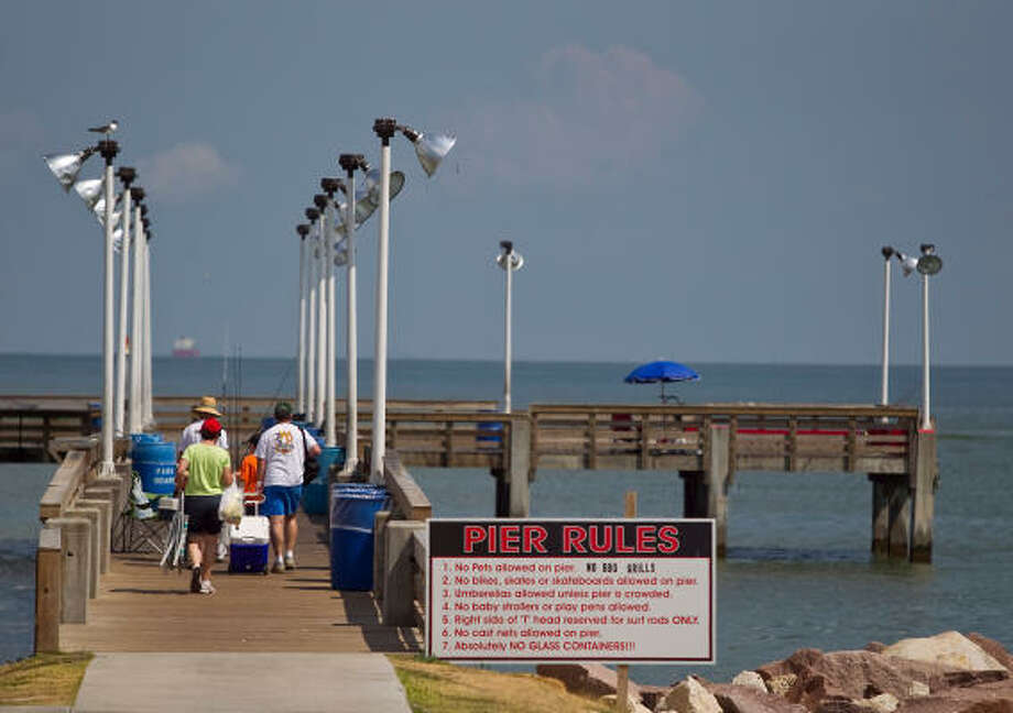 Fishing is a popular family activity at Seawolf Park on Pelican Island in Galveston. The development of a new container terminal could turn the tranquil  spit of land in Galveston Bay into a bustling freight center, a prospect that some Galvestonians say they would welcome. Others have expressed concern. Photo: Nick De La Torre, Chronicle