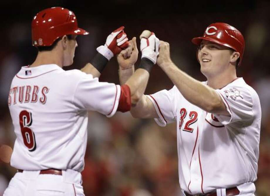 Reds center fielder Drew Stubbs, left, reaches home after his two-run homer off Astros starter Brett Myers. Photo: Al Behrman, AP